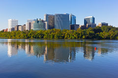 Rosslyn skyscrapers in the early morning with reflections in Potomac River. Stock Image