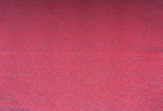 Rosso, color scarlatto, fondo marrone rossiccio Fotografia Stock Libera da Diritti