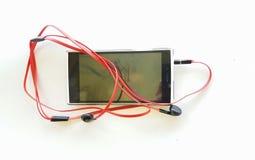 Rosso delle cuffie del telefono cellulare isolato nel bianco Fotografia Stock Libera da Diritti