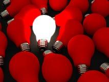 Rosso e sulla lampadina Fotografie Stock