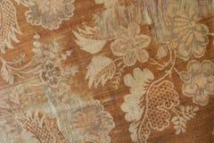 Rost färbte Baumwollgewebe mit Muster von Blumen und von Blättern Lizenzfreie Stockbilder