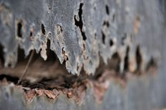 Rosta metall, skada av rost- och korrosionsbakgrund Arkivbild