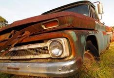 Rosta tappninglastbilen Arkivbild