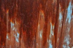 Rostad metalltextur, bruna färger som är blåa och fotografering för bildbyråer