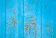 Rostade blått belägger med metall väggen texturerar Royaltyfri Foto