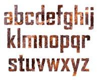 Rostade bokstäver Arkivbild