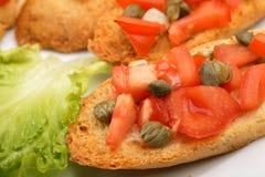 Rostade bröd med tomater Royaltyfri Foto
