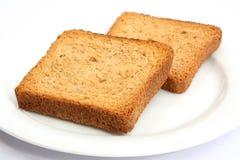 rostat bröd för 03 platta Arkivfoto