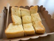 Rostat bröd med den valda fokusen för condensedmilk Fotografering för Bildbyråer