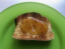Rostat bröd och honung från Kreta Grekland Arkivfoton