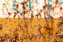 Rostat stål, i guling- och vitfärg Royaltyfri Fotografi