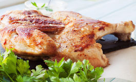 Rosted chicken on a slate plate Stock Photos