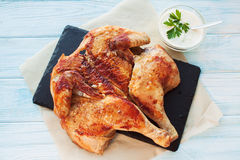 Rosted chicken on a slate plate Royalty Free Stock Images