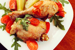 Rosted chicken with tomatoes, toned Stock Photo