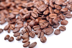 Rosted coffee grains on white backgorund Royalty Free Stock Image