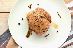 Rosted pork meat tenderloin with black pepper and rosemary on wood prepared to cook Royalty Free Stock Image