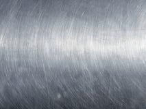 Rostfritt ståltextur med runda skrapor Arkivbild