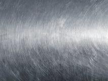 Rostfritt ståltextur med runda skrapor royaltyfria bilder