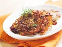 Rosti. Potato pancake or rosti with basil, selective focus Stock Photo
