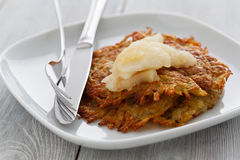 Rosti with Apple Compote. On a wooden background Stock Images