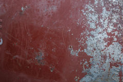 Rostig åldrig röd metallbakgrund Arkivfoto