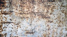 rostig bakgrund för metallväggtextur arkivbild