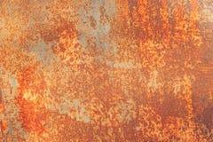 Rostig bakgrund f?r orange metall, metallgrungetextur arkivfoton