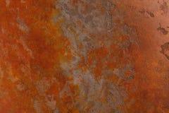 Rostig bakgrund med fläckar och skrapor Arkivbild