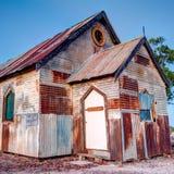 Rostig gammal kyrka på den blixtRidge Australia 1x1 vinkeln arkivfoton