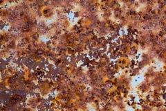Rostig metallbakgrund med spår av gammalt ljus - blå målarfärg Arkivbild