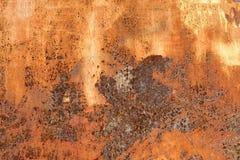 Rostig metallbakgrund, textur Arkivfoto