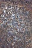 Rostig och sliten yttersida av järnplattan Fotografering för Bildbyråer