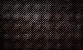 Rostig rostfri metall texturerad perforerad yttersida Fotografering för Bildbyråer