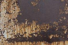 Rostig textur för gammal metall Skalning målad yttersida Grungebakgrund med skadad målarfärg Abstrakt baner kopiera avstånd Arkivfoto