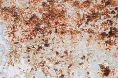 Rostig texturerad metall för gammal målarfärg arkivfoto