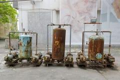 Rostiga metallbehållare i den redtory idérika trädgården, guangzhou, porslin Royaltyfria Bilder