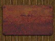 Rostige Platte auf Brettern Lizenzfreie Stockbilder