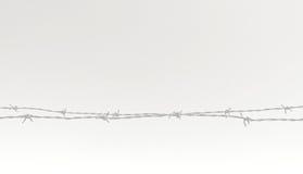 Rostige Stacheldrahtzaunnahaufnahme Lizenzfreies Stockfoto