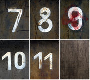 Rostige Zahlen 7-11 Lizenzfreie Stockfotografie