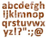 Rostiger Alphabetsatz lokalisiert stock abbildung