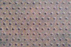 Rostiger Hintergrund des Eisens mit Punkten Lizenzfreies Stockbild