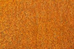 Rostiger orange Metallhintergrund Stockfotos