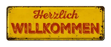 Rostiges Metallschild der Weinlese - deutsch für Willkommen - Herzlich-willkommen stockbilder