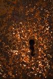Rostiges Schlüsselloch des Eisens Stockbilder