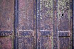 Rostigt dörrbakgrundsfoto Arkivfoto