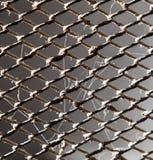 Rostigt metallraster som en bakgrund textur Fotografering för Bildbyråer