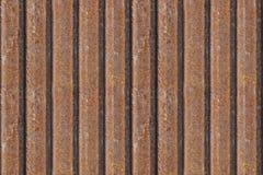 Rostigt metallstaket, sömlös bakgrund rostig textur för metall Järn gammalt industriellt för zinkyttersidarost smutsar ner den sö Arkivfoto