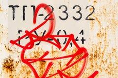 Rostmetall och grafitti Arkivfoto