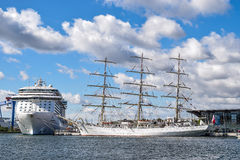 Rostock, Germany - August 2016: DAR MLODZIEZY and Regal Princess. Royalty Free Stock Photography