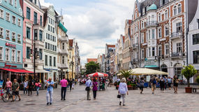ROSTOCK, GERMANY - CIRCA: Kropeliner Strasse is Rostock`s main pedestrian street. Which features many historic buildings and many markets stalls Royalty Free Stock Images